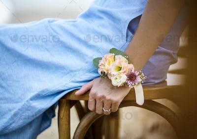 Closeup of bridesmaid wearing a corsage