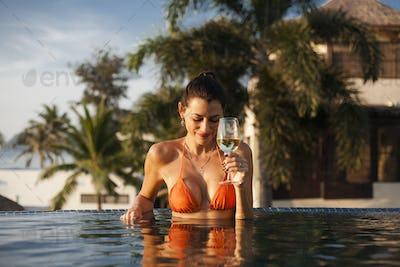 Beautiful woman relaxing in a swimming pool