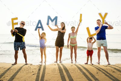 Family holding up the word family