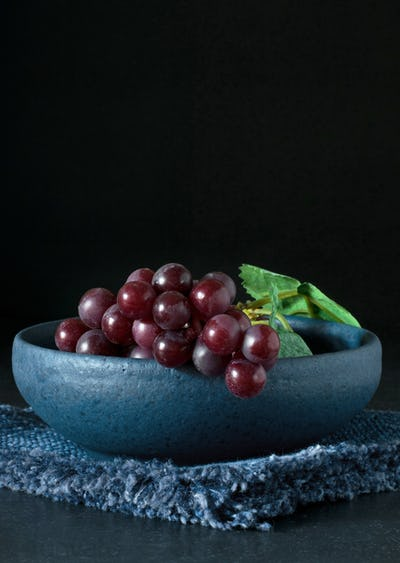 Red grapes in a blue bowl