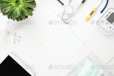 Medical Instruments With Digital Tablet And Plant On White Table