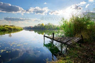 Old pier on pond