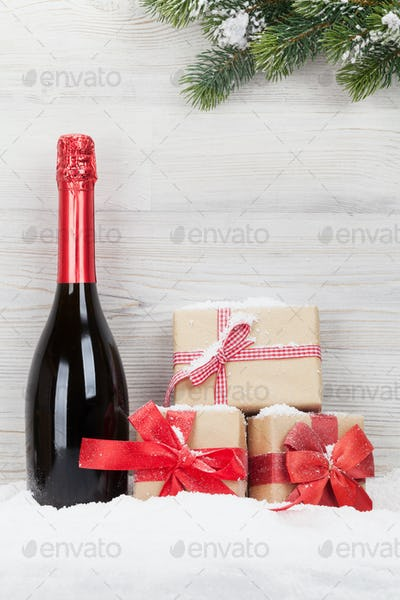 Christmas gift boxes, champagne bottle