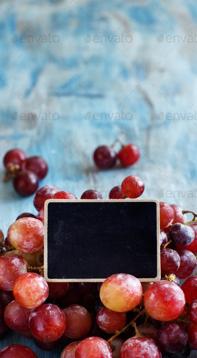 Grapes and a small chalkboard