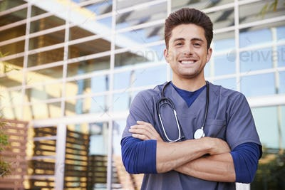Young Hispanic male healthcare worker outdoors, portrait