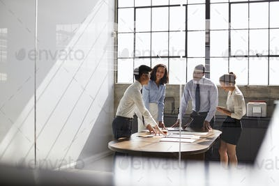 Business team seen through window working together in office