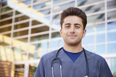 Hispanic male healthcare worker outdoors, head and shoulders