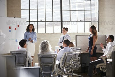 Female manager and colleagues at a brainstorm meeting