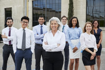 Senior businesswoman and colleagues outdoors, portrait