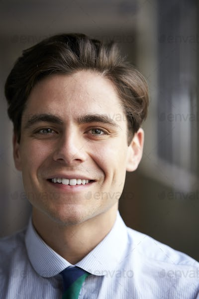 Close up head and shoulders of young white businessman