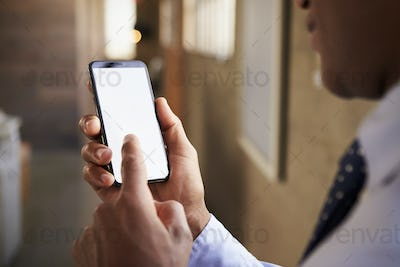 Close up of mixed race man using smartphone