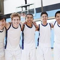Portrait Of Male High School Basketball Team On Court