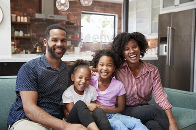 Portrait Of Family Relaxing On Sofa At Home Together