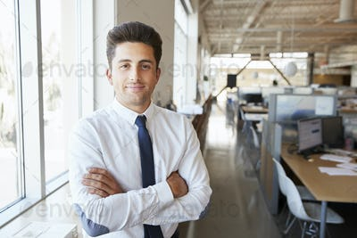 Young Hispanic male architect in office looking to camera
