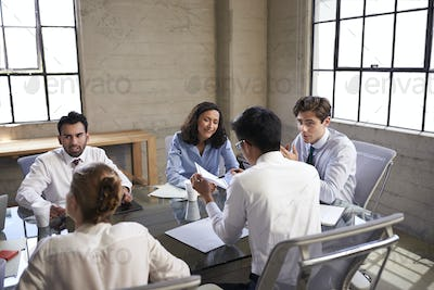 Business colleagues talking in a meeting room