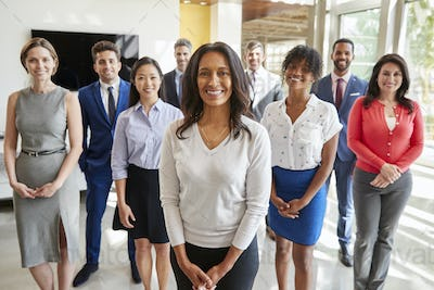 Mixed race businesswoman and business team, group portrait