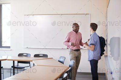 High School Tutor Talking With Male Student After Class