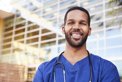 Smiling black male healthcare worker, head and shoulders