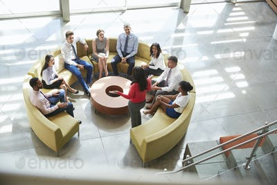 Businesswoman presenting at team meeting, elevated view