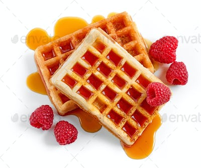 waffles with syrup and raspberries