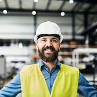 A portrait of an industrial man engineer in a factory.