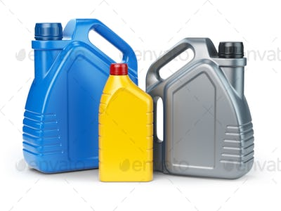 Different types of plastic canisters of motor oil on white isola