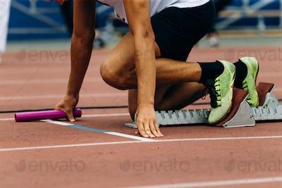 start man runner with baton in hand