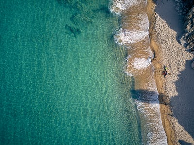 Beautiful beach with family top view shot
