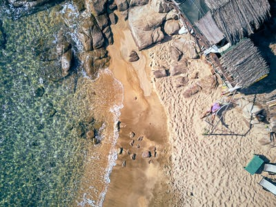 Man in hammock on a beach aerial view