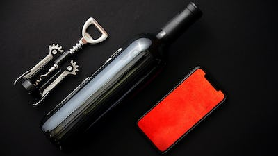 Red wine bottle, corkscrew and boxed christmas gift