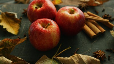 Apples with condiments on table