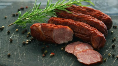 Smoked sausage and spices on board
