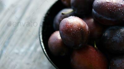 Closeup of wet fresh plums
