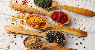 Spoons with colorful mix of spices