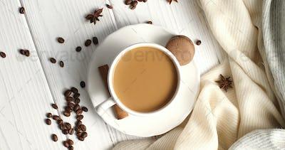 White mug of coffee on table