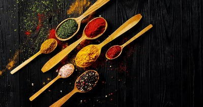 Different spices placed in spoons