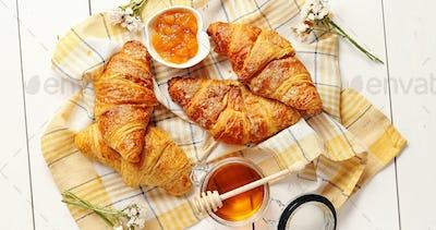 Croissants and condiments composition