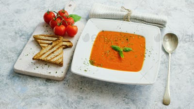 Tomato soup served with crisp bread