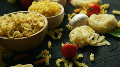 Bowls full of macaroni and tomatoes