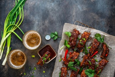 Hot barbecue ribs with hoisin sauce and beer, copy space