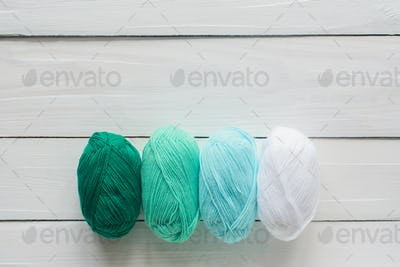 knitting clew and on white wooden background