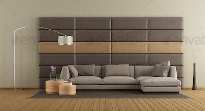 Brown sofa against leather panels