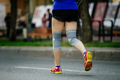 woman runner with knee pads