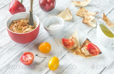 Bowl of hummus with and tortilla chips