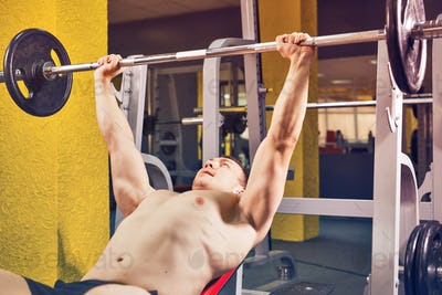 Sport, bodybuilding, training and people concept - Fitness man workout with barbell in gym