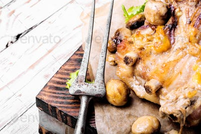 Baked meat with forest mushrooms