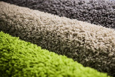 set of multi-colored rugs for home at store
