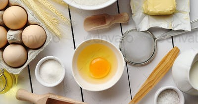 Utensils and pastry ingredients on table