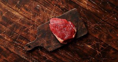 Raw meat on chopping board