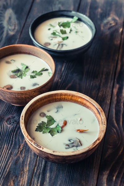 Bowls of thai tom kha soup